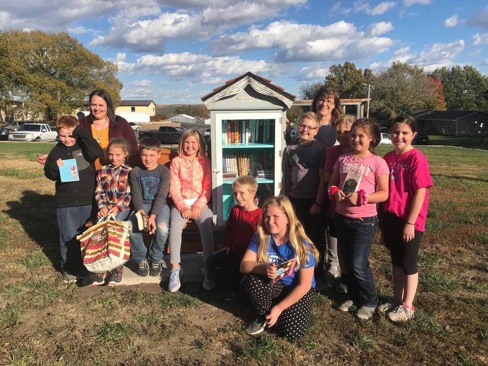 Alma Elementary School book club installs little library