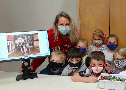 "Some the Maple Hill Kindergarteners with the new monitor...  featuring ""Riley the Museum Dog""."