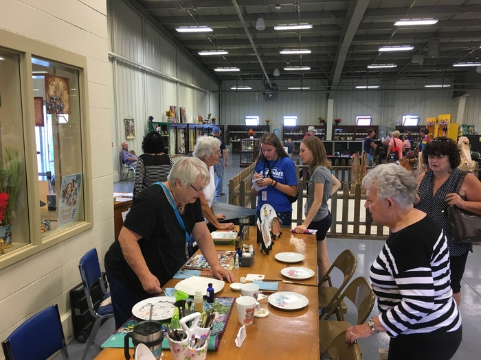 Kaytlyn Meseke and Eleanor Badeker interview at the china painting demonstration at the Kansas State Fair.