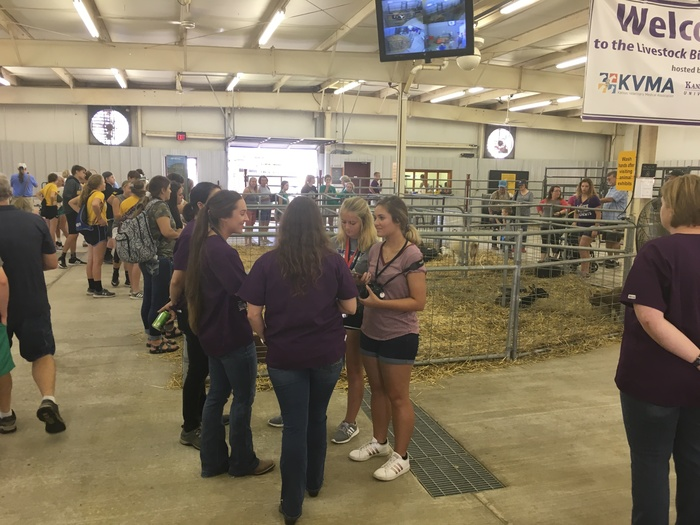 Emma Frey and Kendyl Bolinder interview veterinarians in the animal birthing center at the Kansas State Fair.