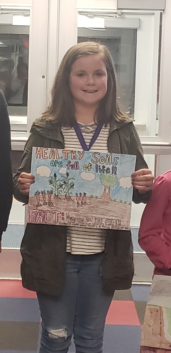 Aubrey and her winning poster!