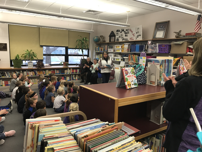 Shirley Oliver's Research Club presents books to MHE