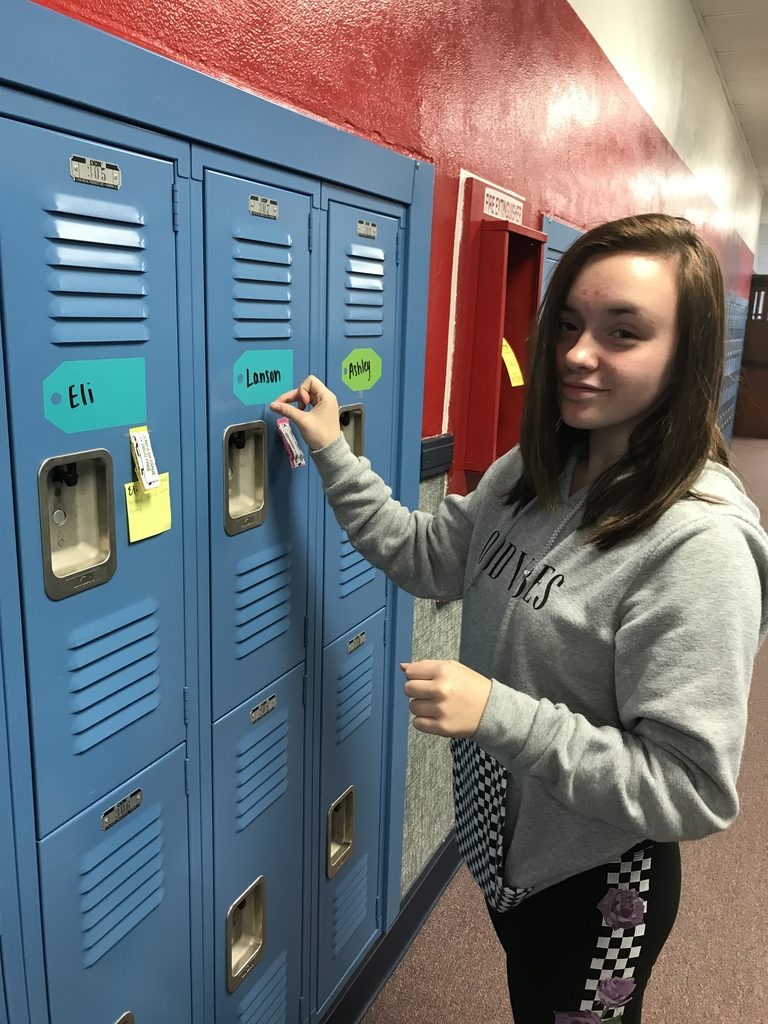 Danielle placing candy on lockers!