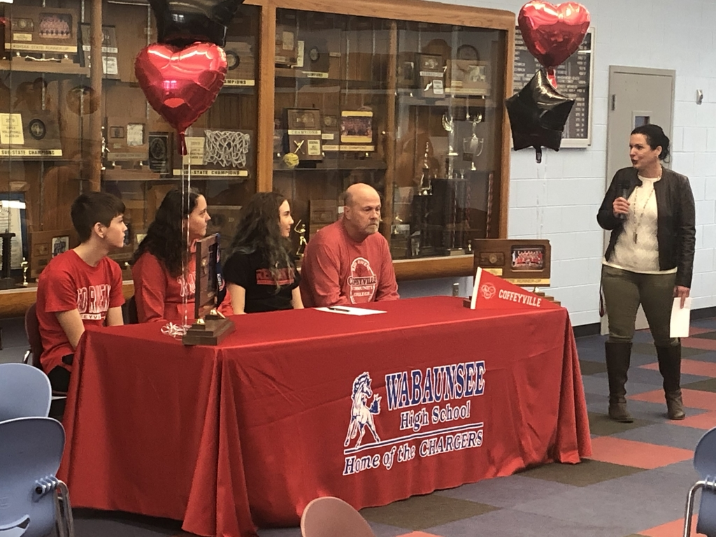 Megan signing with Coffeyville