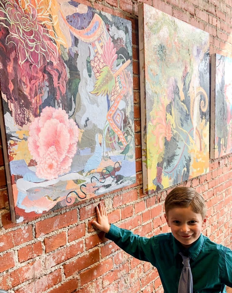 Leo with Alison Mary's Kay's Artwork at The Volland Store.
